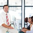 Smiling senior manager in a call center — Stock Photo #10309158