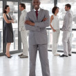 Afro-american male leader with his team — Stock Photo #10309194
