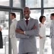 Afro-american male leader with his team — Stock Photo #10309196