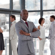 Afro-american male leader with his team — Stock Photo #10309200