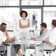 Female business woman giving a presentation — Stock Photo