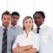 Confident business team looking at the camera — Stock Photo #10309273