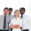 Serious business team looking at the camera with copy-space — Stock Photo #10309275
