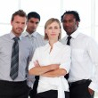 Serious business team looking at the camera — Stock Photo #10309277