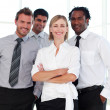 Business team smiling at the camera — Stock Photo #10309282