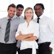 Business team smiling at the camera - Stock Photo