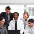 Multi-ethnic business team in an office — Stock Photo