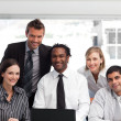 Business team working in an office looking at the camera — Stock Photo #10309300