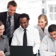 Multi-ethnic business team working with a laptop — Stock Photo
