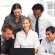 Multi-ethnic business using a laptop in an office — Stock Photo #10309303