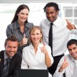 Royalty-Free Stock Photo: Business team working together with thumbs up