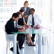 Female manager with her team in office — Stock Photo #10309311