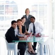 Stock Photo: Business team working together in office