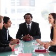 Foto Stock: Business discussing in meeting