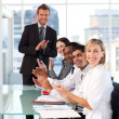 Business team clapping in meeting — Stock Photo #10309414