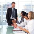 Business team applauding his colleague — Stock Photo #10309420