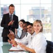 Senior leadership applauding in meeting — Stock Photo #10309428
