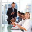 Businessteam clapping at the end of a presentation — Stock Photo