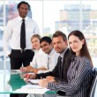 Business looking at the camera in a meeting — Stock Photo