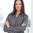 Stock Photo: Young businesswomwith folded arms