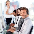 Smiling female leader managingher team in a call center — Stock Photo #10309471