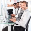 Smiling female leader managingher team in a call center — Stock Photo #10309484