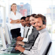 Radiant female leader managingher team in a call center — Stock Photo #10309487
