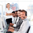 Radiant female leader managingher team in a call center — Stock Photo