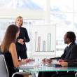 Female manager smiling at her team in a meeting — Stock Photo #10309511