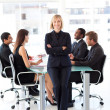 Friendly businesswoman smiling at the camera in a meeting — Stock Photo #10309529