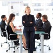 Serious female manager looking at the camera — Stock Photo #10309530
