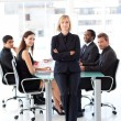 Serious businesswoman with folded arms in a meeting — Stock Photo #10309531