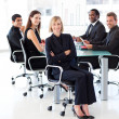Smiling business team sitting in a presentation — Stock Photo