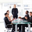 Businesspeople clapping in presentation — Stock Photo #10309550