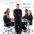 Confident businessman with folded arms in a presentation — Stock Photo #10309592