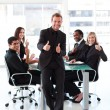 Businessman with thumbs up in a meeting — Stock Photo #10309596