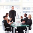 Business applauding colleague in presentation — Stock Photo #10309605