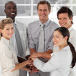 Close-up of smiling business team with hands together — Stock Photo #10309831