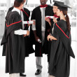 Group of celebrating their Graduation - Stock Photo
