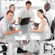 Stock Photo: Young Multi Culutre Business Team at work