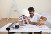 Father and son studying working with plans — Stock Photo