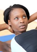 Concentrated woman in gym clothes excercising — Stock Photo