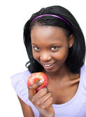 Attractive young woman eating an apple — Stock Photo