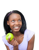 Cute young woman eating an apple — Stock Photo