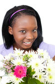 Cute young woman holding flowers — Stock Photo