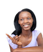 Smiling young woman pointing — Stock Photo
