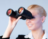 Busines woman looking through Binoculars — Stock Photo