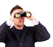 Man looking through binoculars surprise — Stock Photo