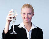 Business woman Holding a Champagne Glass — Stock Photo
