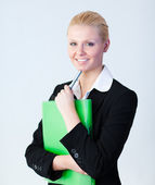 Business woman standing holding a folder — Stock Photo